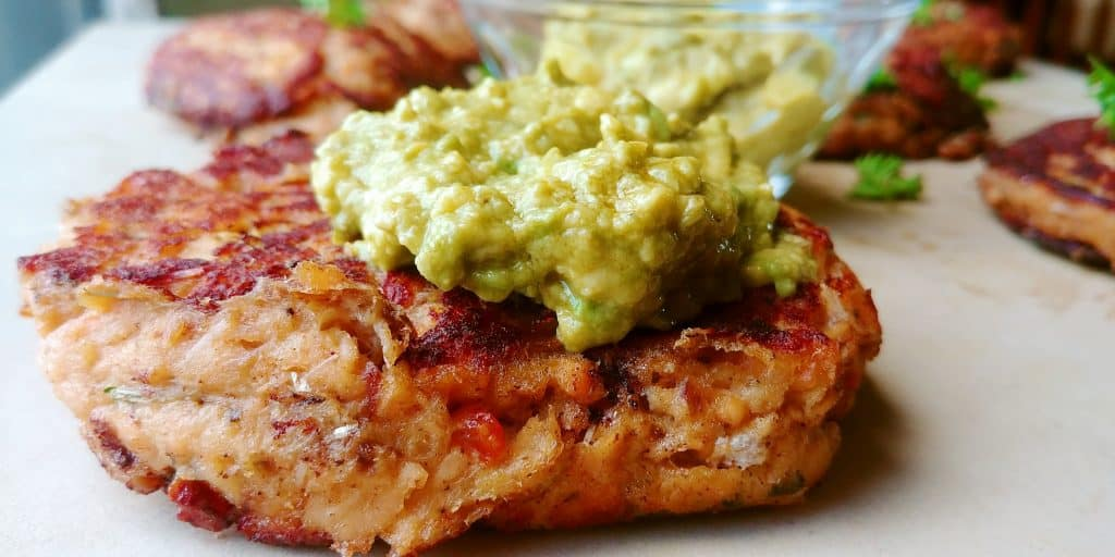 These salmon burgers are perfect enough to eat on their own. However, when dressed with the guacamole, the flavors will explode in your mouth. Perfect for night that calls for an easy quick dinner. Savory Thoughts | Salmon Burger with Guacamole. #salmonburger #salmonpatties #patties #salmoncakes #guacamole #homemade #easyrecipe #easyrecipesalmonburger #easysalmonburger #easysalmonpatty
