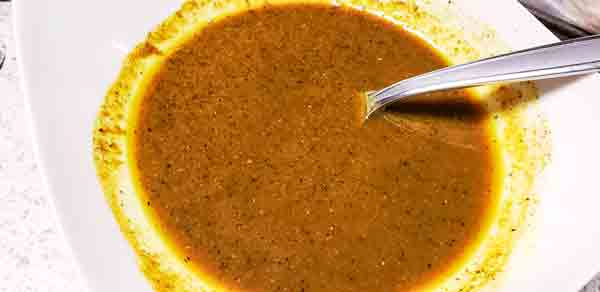 Roasted chicken curry seasoning mixture in white bowl