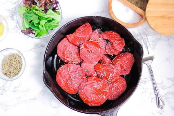sliced red beets in skillet