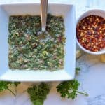 Scrumptious chimichurri cilantro made with fresh parsley. Chimichurri dressing blended with garlic, olive oil, and apple cider vinegar. Delicious on beef, fish, and chicken. It is gluten-free, paleo, and vegan! If you have never made this chimichurri sauce, you are in for an EPIC change with your taste buds. This herbal sauce is filled with bold flavors.