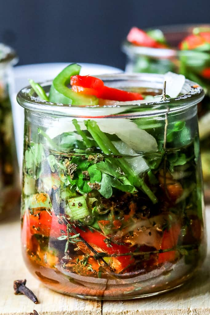 Learn to make Haitian Epis as it is used as the base for almost all Haitian recipes. It is a perfect blend of fresh natural herbs, garlic, olive oil, vinegar, and peppers.