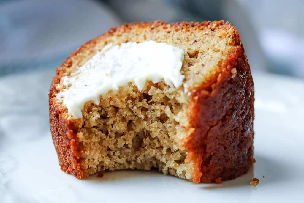 Plantain Bread - Savory Thoughts - Plantain Bread topped with butter and bite off. If you are not familiar with plantain bread (plantain cake), you are in for a treat. This bread is gluten-free, delicious, and is a perfect alternative to banana bread and a great way to use your ripe plantains.