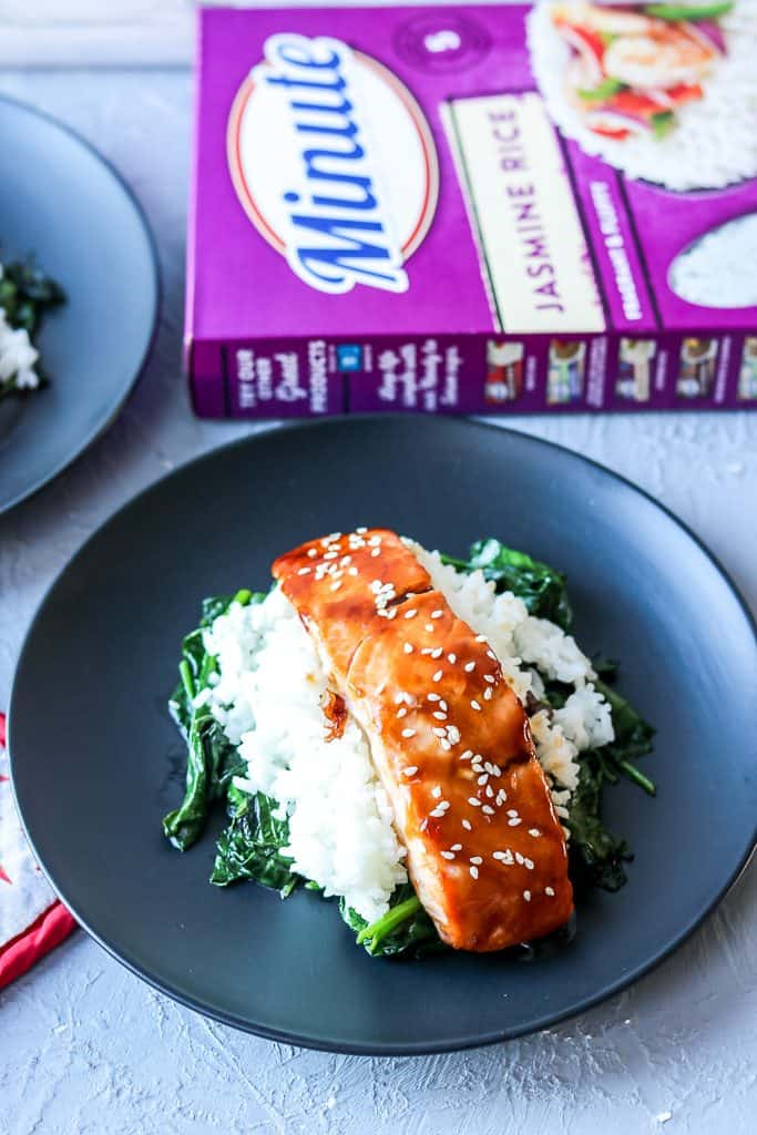 Wholesome Salmon Rice Bowl Recipe. Simple Asian Flare salmon rice bowl that's easily made at home. Gluten-Free and is laid as well serve on a bed of spinach. Perfect for easy dinner night. Get the full Wholesome Rice Bowl recipe at www.savorythoughts.com