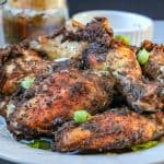 Jamaican Jerk Chicken Wings – flavorful, ridiculously delicious, and easy to make right in your kitchen. No need to travel to the local Caribbean store to get these wings. These wings are full of spice and extremely addictive. #Jamaicanjerkwings #spicywings #jerkwings #jamaicanrecipe #homemadeseasoning #jerkseasoning