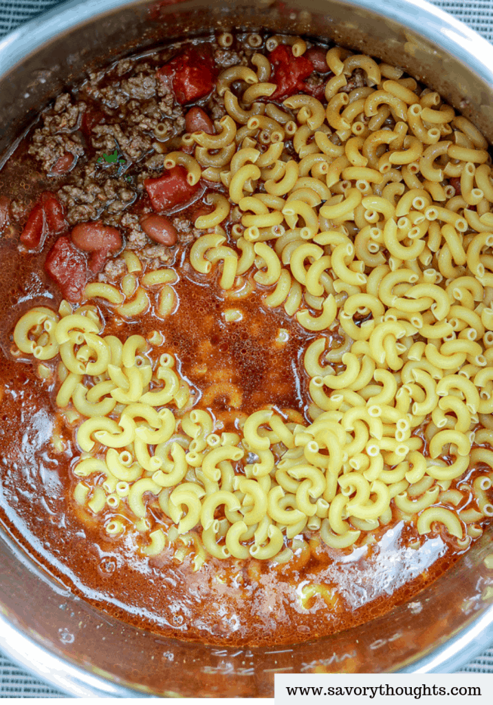 This Instant Pot Chili Mac And Cheese is totally ON POINT! Combine two of your favorite comfort foods in ONE POT to create the ultimate cheesy ONE POT MEAL. It is a hearty, quick, delicious, and comforting recipe for chili mac and cheese. Perfect for busy nights, one pot wonder chili mac and cheese recipe. This tasty chili mac and cheese is perfect for a family meal.