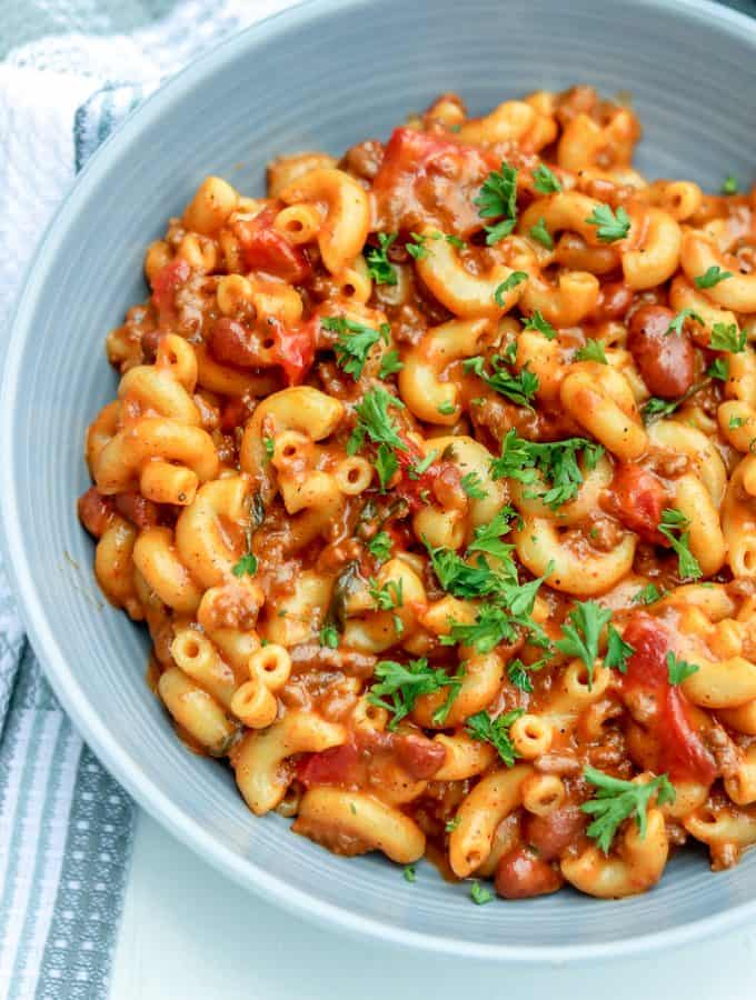 Instant Pot Chili Mac and Cheese. This Instant Pot Chili Mac And Cheese is totally ON POINT! Combine two of your favorite comfort foods in ONE POT to create the ultimate cheesy ONE POT MEAL. It is a hearty, quick, delicious, and comforting recipe for chili mac and cheese. Perfect for busy nights, one pot wonder chili mac and cheese recipe. This tasty chili mac and cheese is perfect for a family meal.