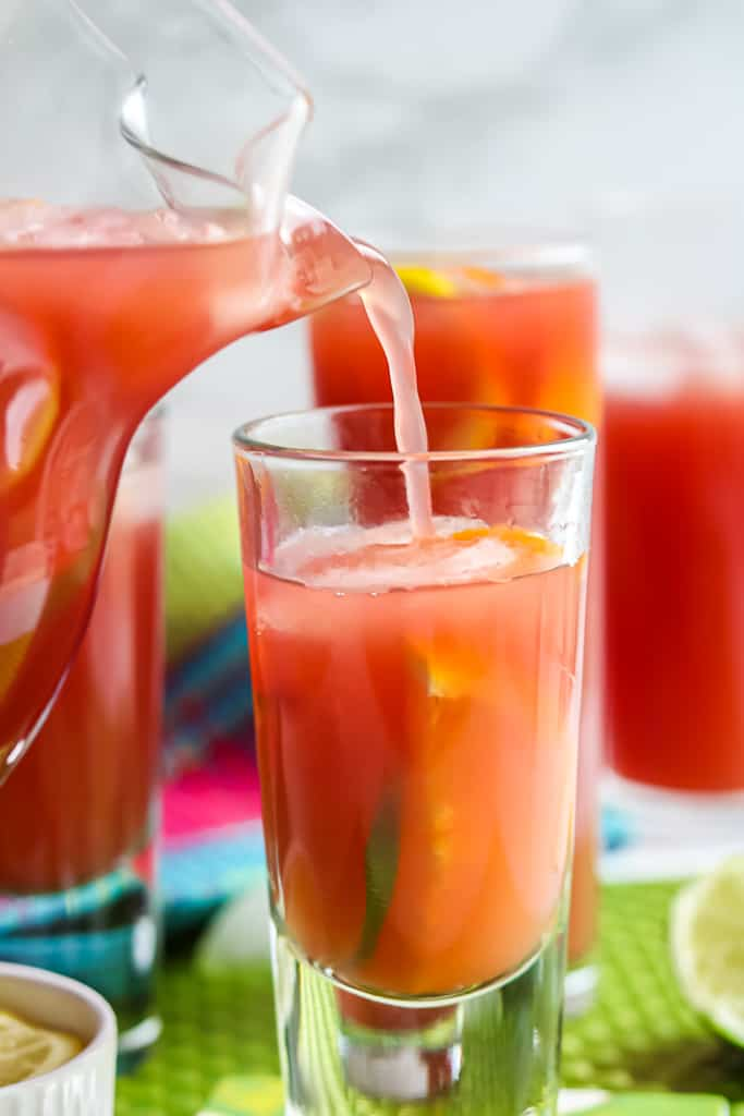 Non-Alcoholic Sangria Recipe (Sangria Mocktail) being poured into a glass.