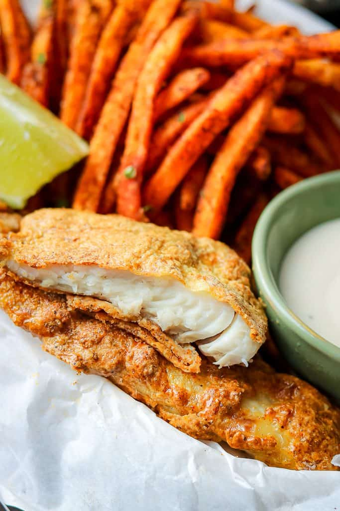 These Air Fryer Fish and Chips are exactly what you need to put on the menu every week! Air Fryer recipes are an excellent way to enjoy healthy, crispy foods. The air fryer tilapia is cooked to perfection without using a large amount of oil. #airfryerfishandchips #glutenfreefish #bestfishandchips #Airfryerfishandchipsrecipes