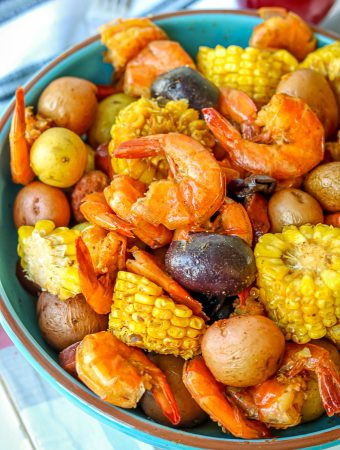 Low Country Shrimp Boil Pot Recipe – there's nothing better to enjoy in the summer like good shrimp boil recipe. This Instant Pot low country boil recipe has summer and deliciousness written all over it! Definitely feeds a crowd. It is finger-licking-good and is filled with seafood flavor/seasoning from the old bay seasoning. #shrimpboilpot #lowcountryshrimpboil #seafoodboilpot #shrimpboilrecipe #lowcountryshrimpboil #oldbayseasoning #shrimpboilspices