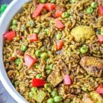 Unbelievable Caribbean Chicken and Rice recipe that's flavorful and make an easy one-pot meal which is perfect for meal prep. #chickenandricedbaked #caribbeanchickenandrice #chickenricecasserolerecipes