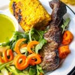 Easy Grilled Marinated Country Style Ribs plated with spiral carrots, arugula and zucchini, with grilled corn #MarinadesWithMazola #MakeItWithHeart #CollectiveBias