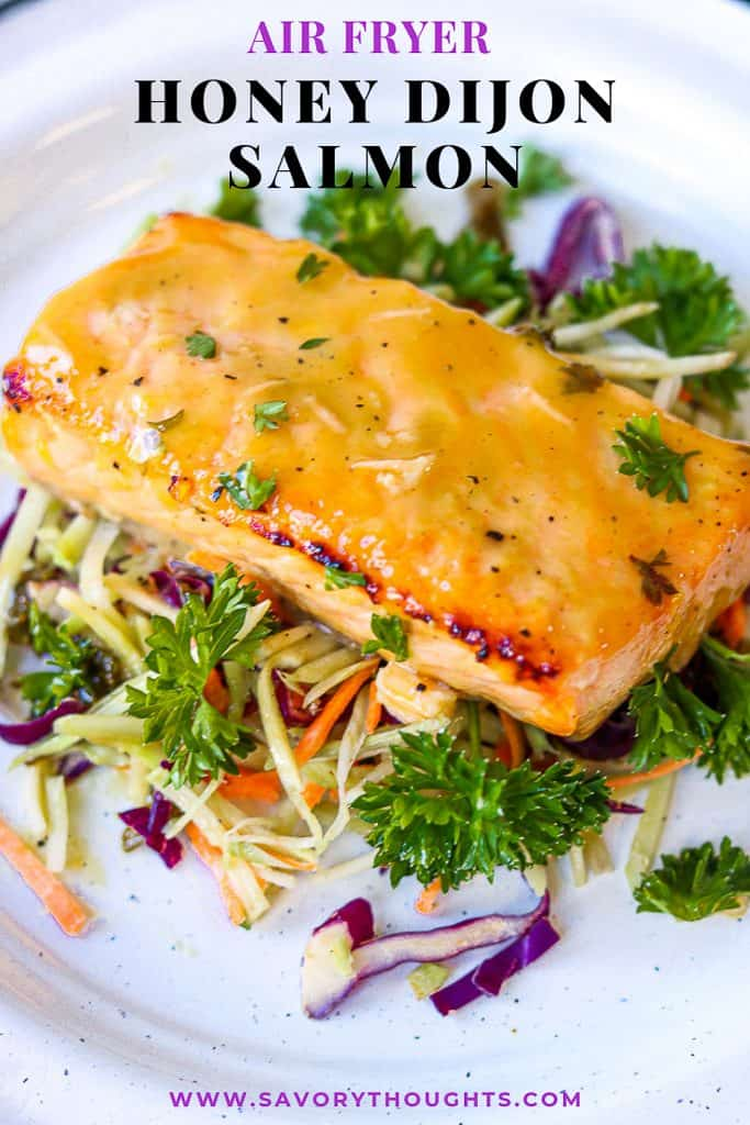 Honey Dijon Salmon - Air Fryer Recipe is a quick, easy, and a healthy weeknight dinner. A hearty baked salmon recipe that's fuss-free! Baked salmon fillet made in the air fryer to perfection. A flavorful simple meal that that's ready in 10 minutes. Dijon Salmon   Honey Mustard Glazed Salmon   Savory Thoughts #air fryer #honey #mustard #dijonmustard #recipes #paleo #honeymustardglaze #healthy #lemon. Honey Dijon Salmon - Air Fryer Recipe is a quick, easy, and a healthy weeknight dinner. A hearty baked salmon recipe that's fuss-free! Baked salmon fillet made in the air fryer to perfection. A flavorful simple meal that that's ready in 10 minutes. Dijon Salmon   Honey Mustard Glazed Salmon   Savory Thoughts #air fryer #honey #mustard #dijonmustard #recipes #paleo #honeymustardglaze #healthy #lemon