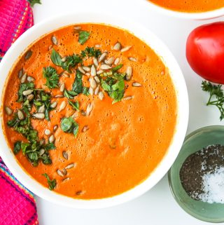 Homemade Tomato Soup recipe topped with fresh herbs