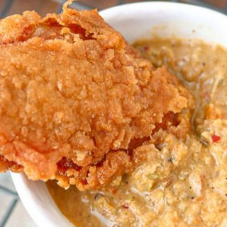 crispy wing dipped in Haitian sauce