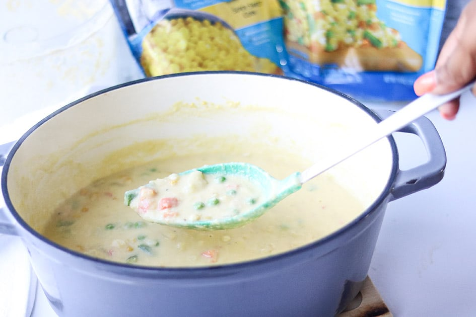 Corn chowder on spoon