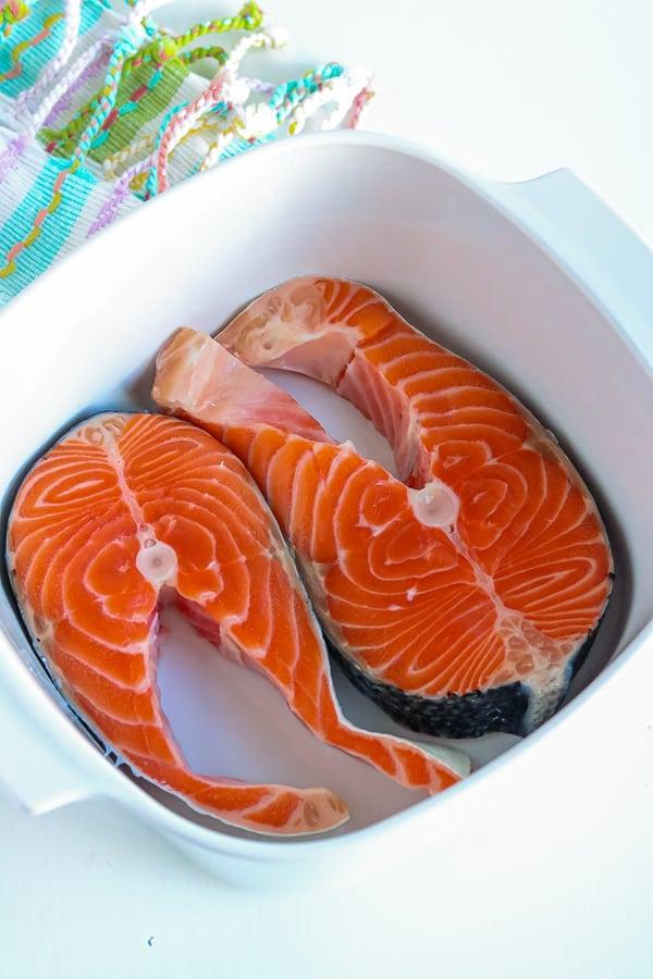 salmon steaks in white bowl