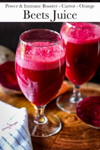 Beetroot Juice with carrots and apples in glass cups