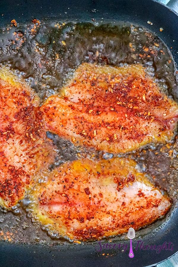 fish frying in oil