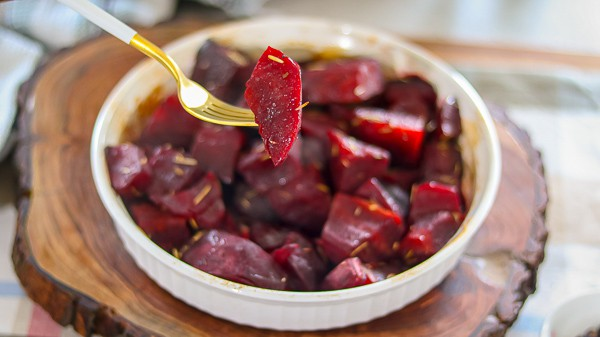 Cooked beets on a fork