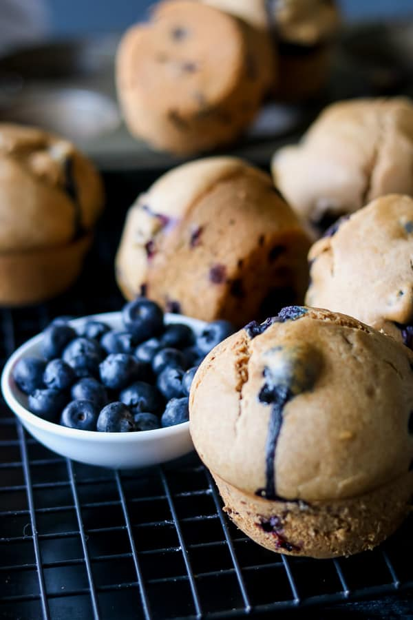 Whole Wheat Baked Blueberry Muffins on cooling rack