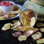 Air Fryer Plantain Chips Recipe On Black board and salsa in the back ground