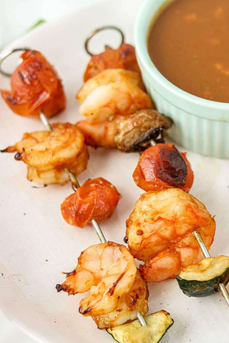 prawn sticks on a plate with peanut sauce