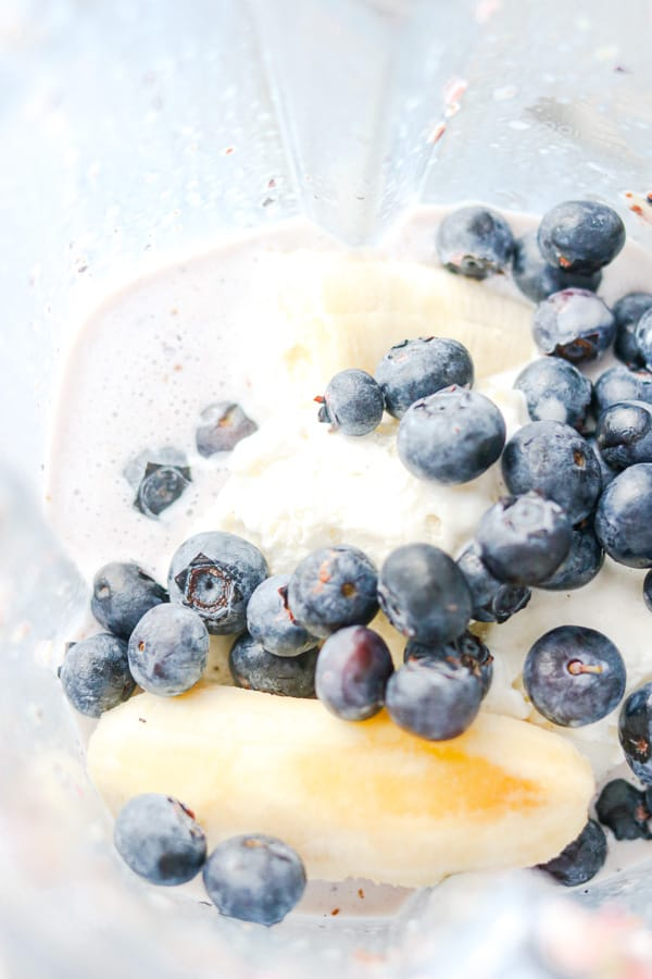 Blueberries, banana, ice cream, milk in blender