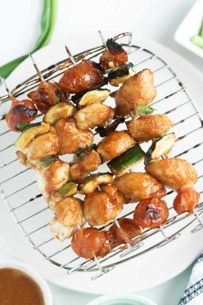 Cooked Thai chicken skewers on air fryer rack