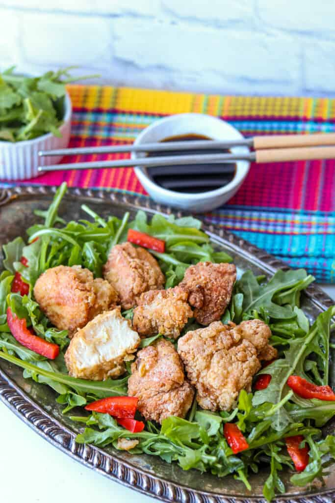 Japanese fried chicken on bed of arugula