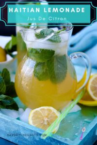 Jus Citron in glass pitcher filled with mint on ice