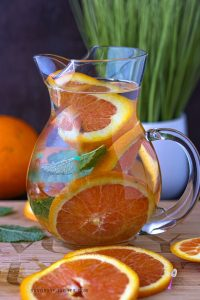 Orange Infused Water In pitcher With oranges slices