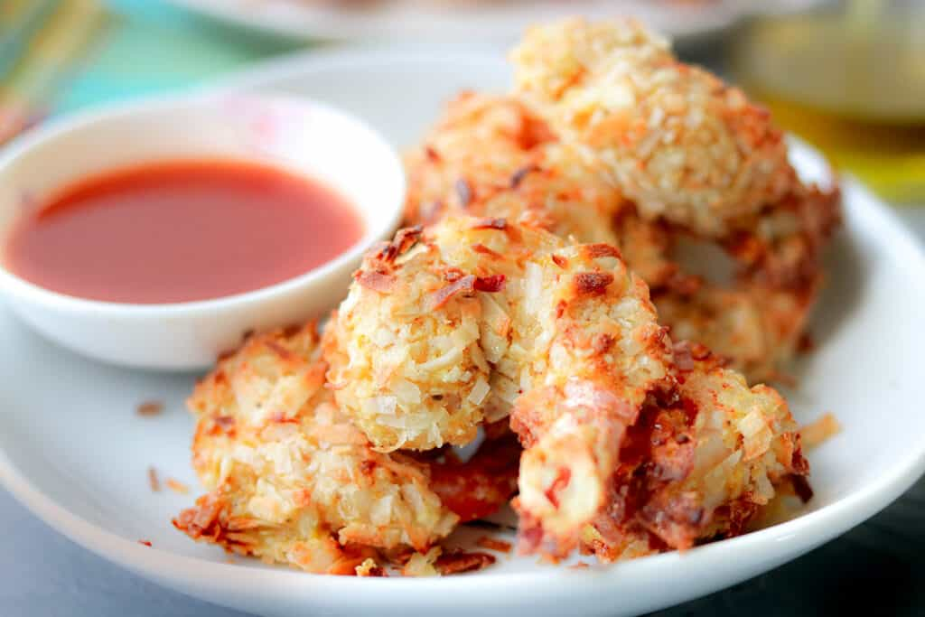 air fryer shrimp with sauce on white plate