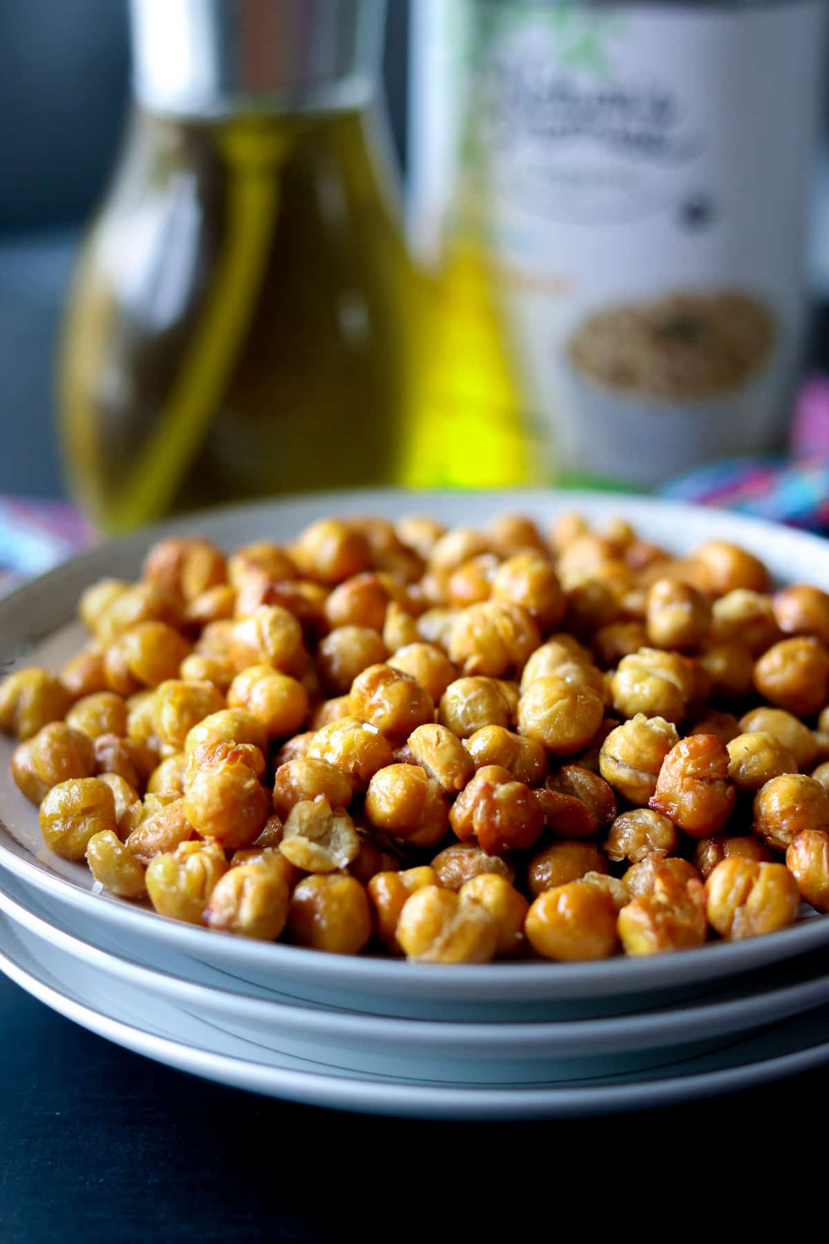 Roasted chickpeas on a stack of white plate