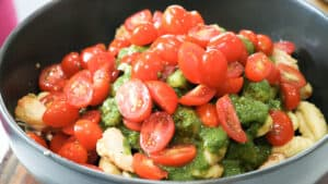 gnocchi topped with tomatoes and pesto sauce