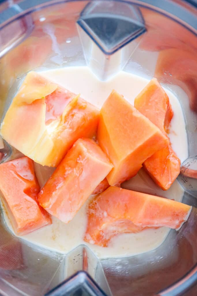 Papaya, and milk in blender.