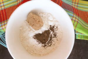 Flour, sugar, spices in a white bowl.