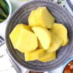 sliced cooked yams in gray bowl