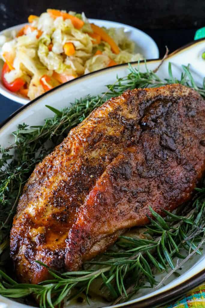 Turkey breast in dish with fresh herbs