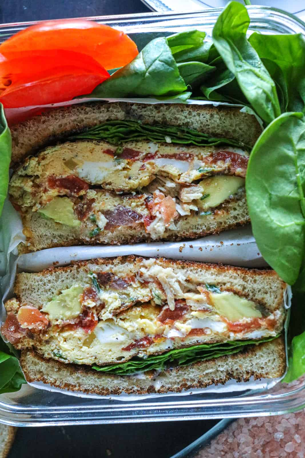 Egg sandwich with spinach and tomatoes