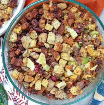 stuffing in baking dish with wooden spoon showing