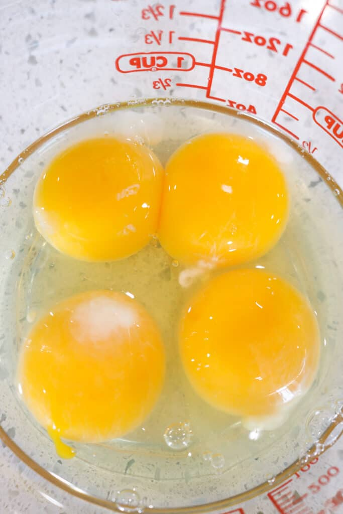 4 eggs in glass measuring cup
