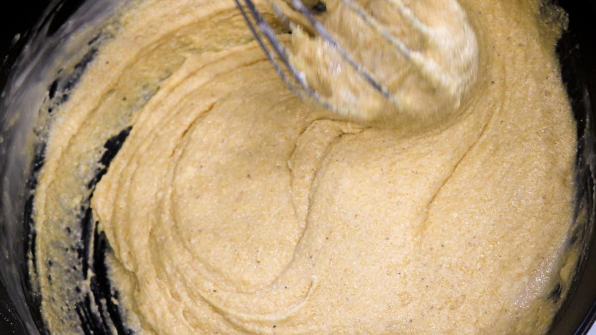 whisking cornbread batter