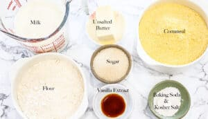 Ingredients on white marble background with words on top of each ingredient