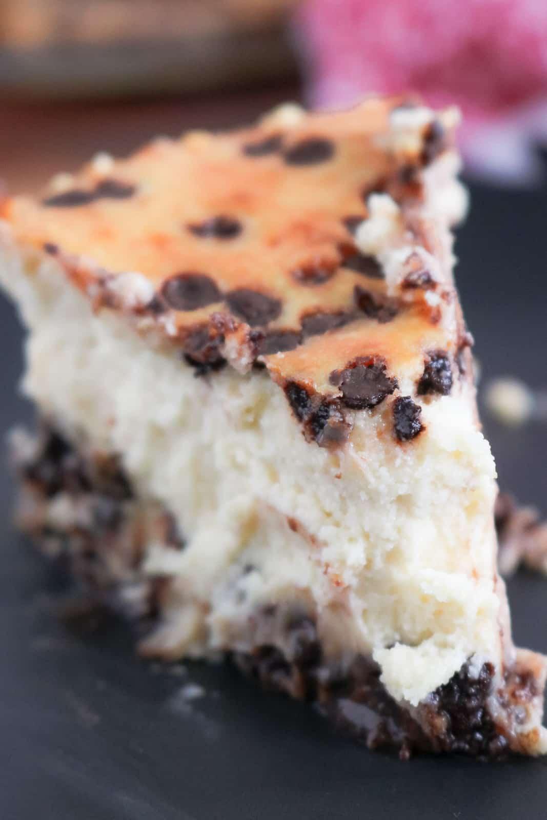 Cheesecake slice on black plate