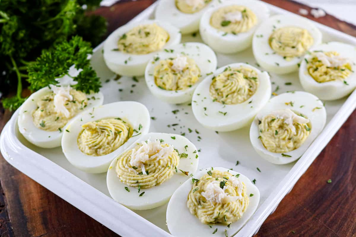 deviled eggs on wooden board