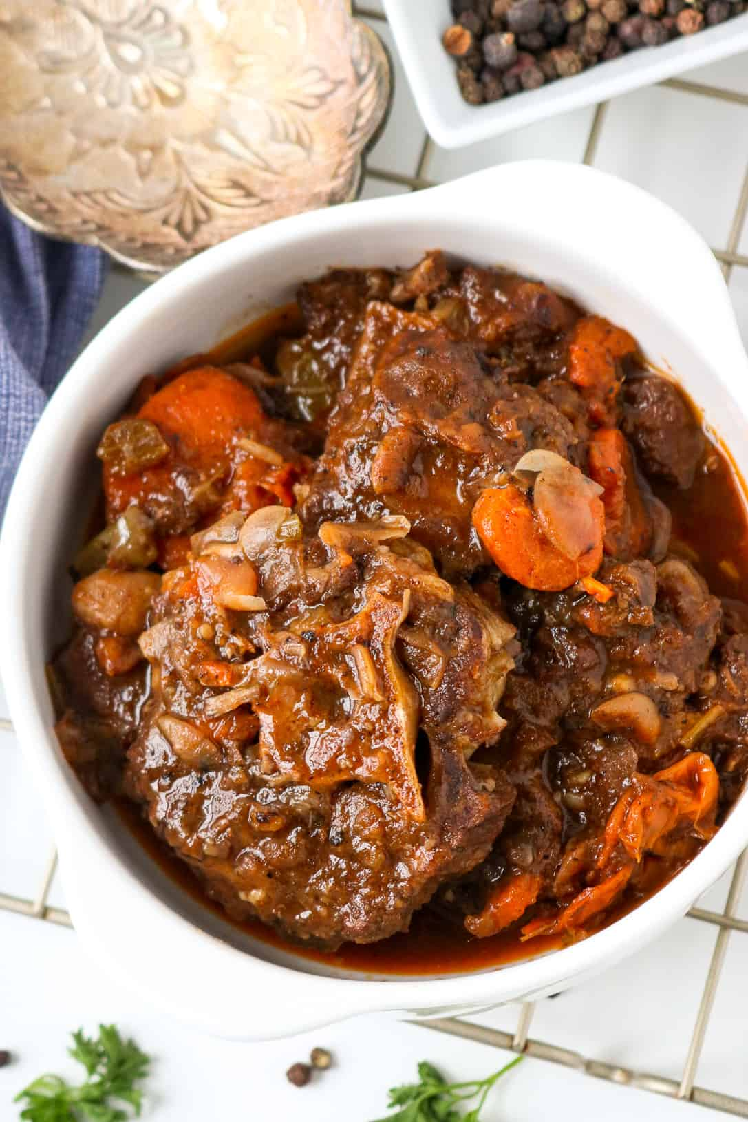Oxtail in white bowl with carrots