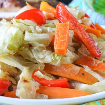 Jamaican Steamed Vegetables Topped With Carrots and Bell Peppers
