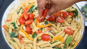 Tomatoes on top of pasta