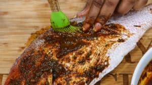 applying seasoning to fish