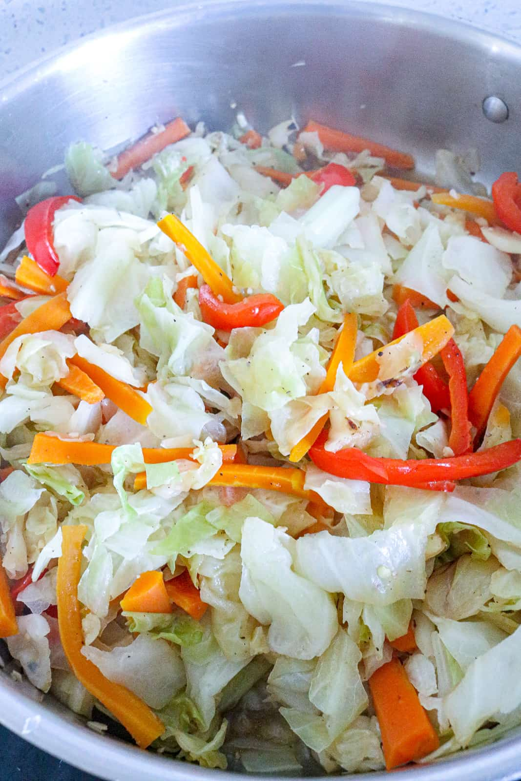 steamed cabbage with peppers in skillet